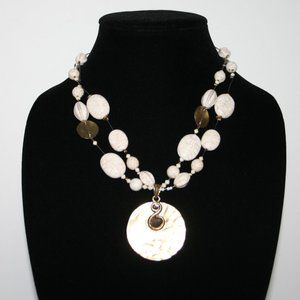 Beautiful silver cream and gold necklace pendant